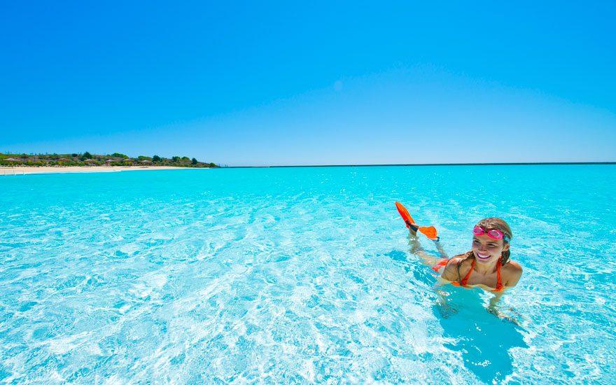 cool-girl-sunbathing-giant-pool