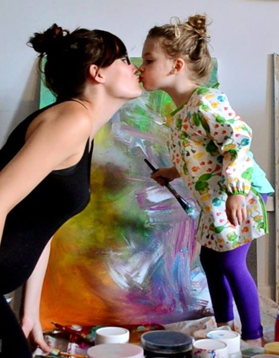 mom painting with toddler