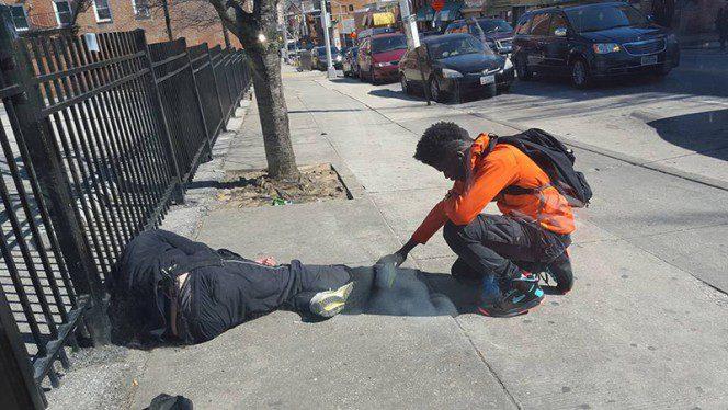 boy praying over homeless man