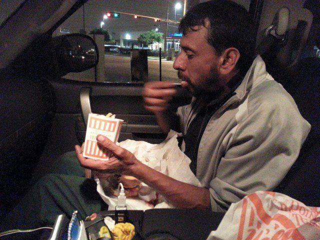 guy buys homeless man food