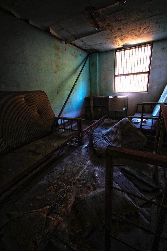 man in abandoned mental hospital
