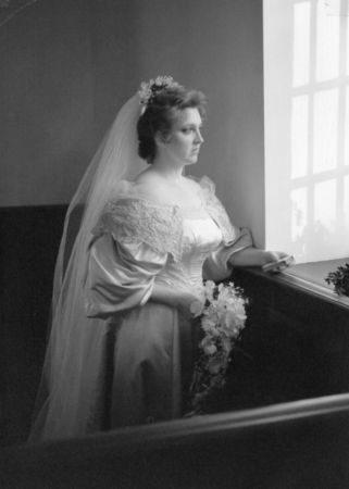 bride wears old wedding dress