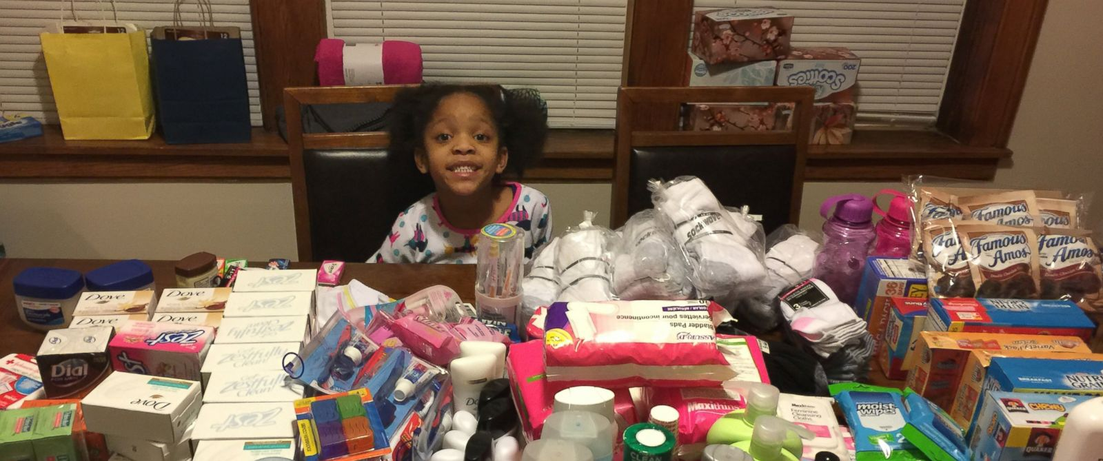 child helps homeless for birthday