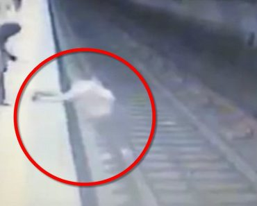woman thrown in front of train