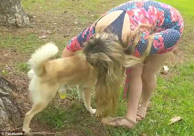woman drinks dog urine