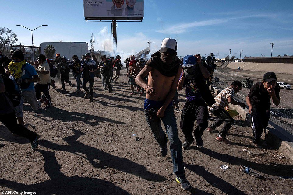US border tear-gassing migrants